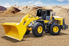Yellow wheel loader on the mining site Stock Photos