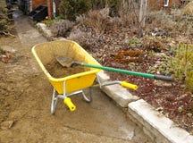 Yellow wheelbarrow Stock Photography