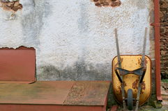 The yellow wheelbarrow. A country scene with a yellow wheelbarrow Royalty Free Stock Photo