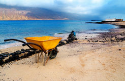 Yellow wheelbarrow on a shore of Graciosa Stock Image