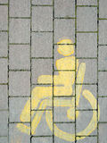 Yellow wheelchair disabled sign. Vertical composition. Royalty Free Stock Photography