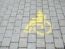 Yellow wheelchair symbolfor disabled access. Royalty Free Stock Image