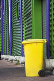 Yellow wheeled garbage can Royalty Free Stock Image