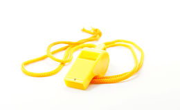 Yellow whistle. On white background Royalty Free Stock Photos