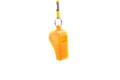 Yellow whistle. Isolated on a white background royalty free stock photo