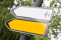 Yellow and white arrow road sign. Royalty Free Stock Photo