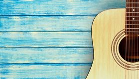 Classical acoustic guitar on wooden background. Yellow white background object isolated equipment art Royalty Free Stock Image