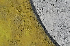 Yellow and white background. Rough concrete wall with two zones painted in yellow and white colors Royalty Free Stock Images