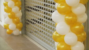 Yellow and white balloons in mall. Concept of celebrating and sale stock video footage