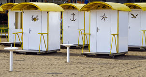 Yellow-white bathing huts Stock Images