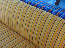 Yellow, white, blue and red striped fabric. Texture useful as a background Royalty Free Stock Images