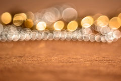 Yellow and white bokeh and wooden texture Stock Image
