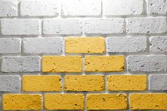 Yellow on white brick wall. In rest room Stock Photos