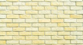 Yellow and white brick wall texture background with space for text. Old bricks wallpaper. Home interior decoration. Architecture. Concept stock image