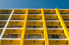 Yellow and white building and blue sky Stock Photography