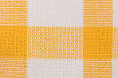 Yellow and white chess towel fabric. Tablecloth texture. Royalty Free Stock Images