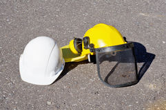 Yellow and white construction helmets Royalty Free Stock Image