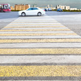 Yellow and white crossing zebra on urban street Royalty Free Stock Photo