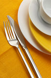 Yellow and white dishware Stock Photos