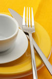Yellow and white dishware Stock Images