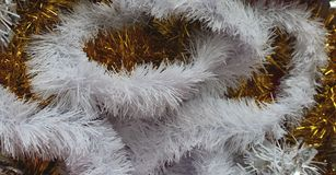 Yellow and white festive fluffy winter holidays decoration. Royalty Free Stock Photos