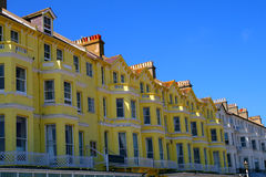Yellow and white flat. Some pretty flats along the British south coast Royalty Free Stock Photo