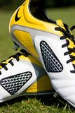 Yellow and white football boots Royalty Free Stock Image