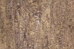 Yellow white gray brown spotted granite surface. rough texture royalty free stock photos