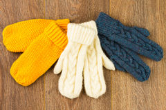 Yellow, white and gray knitting mittens Royalty Free Stock Photos