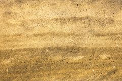 Yellow white gray sand with black holes close up. natural surface texture stock photography