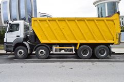 Yellow and white heavy dump truck. Isolated on white background royalty free stock photo