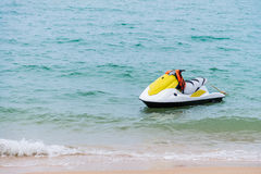 yellow and white Jet ski floating on blue sea,Tropical Ocean, pa Royalty Free Stock Photo