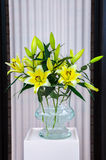 Yellow white lilies in glass vase, Keukenhof Park, Lisse Royalty Free Stock Image