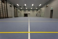 Yellow and white floor court markings in an empty indoor sport venue. royalty free stock images