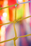 Yellow and white net closeup in children playground.  Royalty Free Stock Images