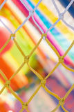 Yellow and white net and very colorful background in children pl. Ayground Stock Photo