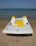 Yellow and White Pedalo Stock Photography
