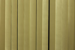 Yellow white plastic strips curtain. Yellow white plastic strips curtain separate building area Stock Photography