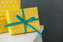 Yellow boxes on dark gray backround Royalty Free Stock Photos