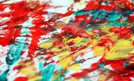Yellow blue orange red phosphorescent vivid paint background, watercolor acrylic painting abstract background. Yellow white red phosphorescent hues, vivid royalty free stock image