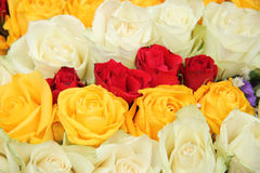 Yellow, white and red roses in a wedding arrangement. Yellow, red and white roses in a wedding centerpiece Stock Photos