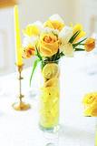 Yellow and white roses in vase Stock Photos
