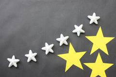 Yellow and white stars are placed on a black background for business ideas and have copy space. stock photo