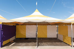Yellow and white striped tent outdoors Royalty Free Stock Photo