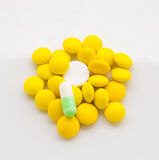 Yellow and white tablet Stock Image