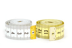 Yellow and white measuring tape isolated on white Stock Photos