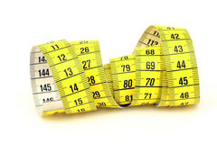 Yellow and white tape measure. Rolled on white background Stock Photos