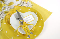 Yellow and white theme Happy New Year table setting Stock Photography