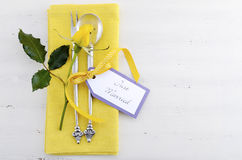 Yellow and white theme wedding table place setting. Royalty Free Stock Photo