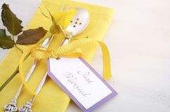 Yellow and white theme wedding table place setting. Royalty Free Stock Images